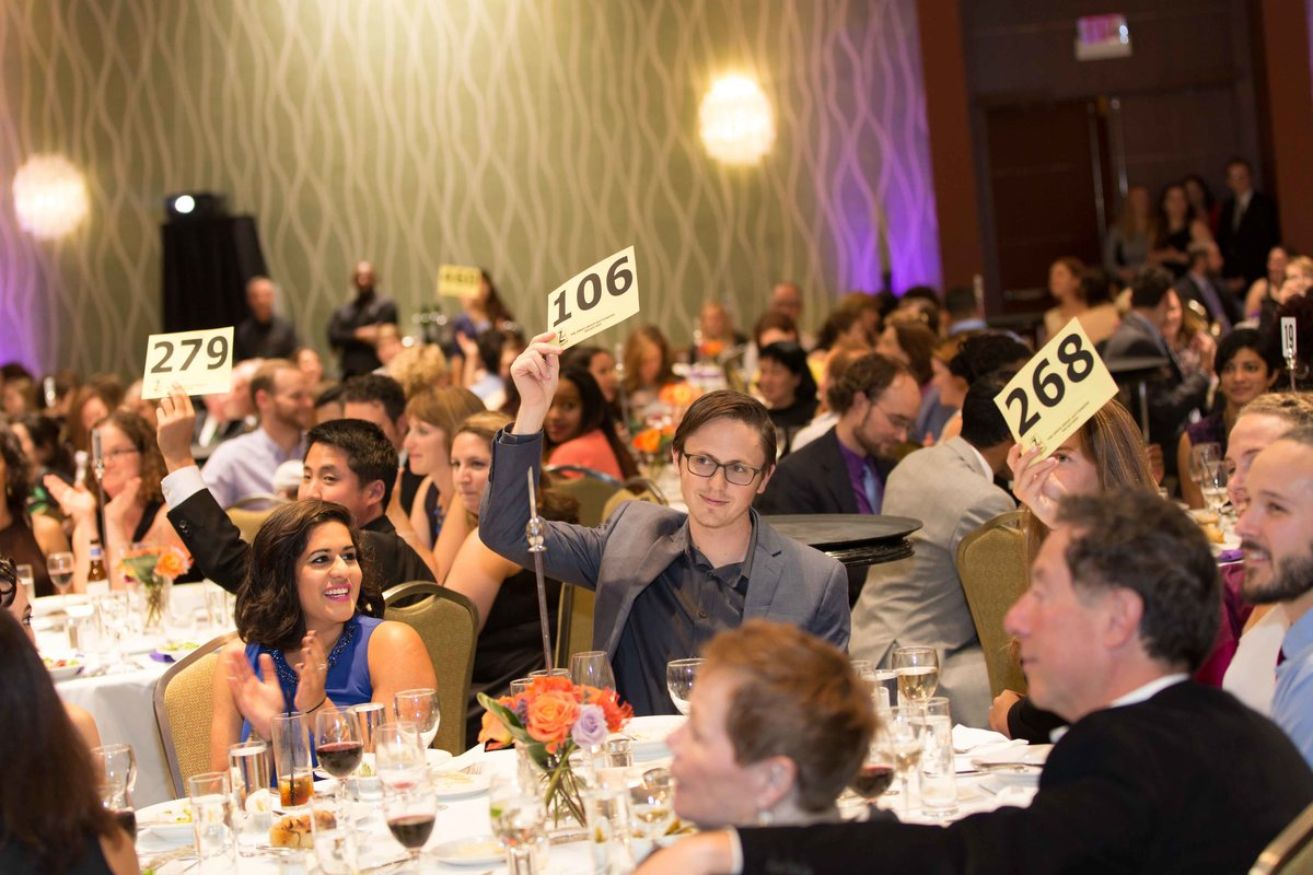 Attendees bidding at Champions for Change Gala