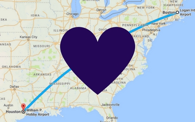 Google map showing line from Boston to Houston with purple heart in middle